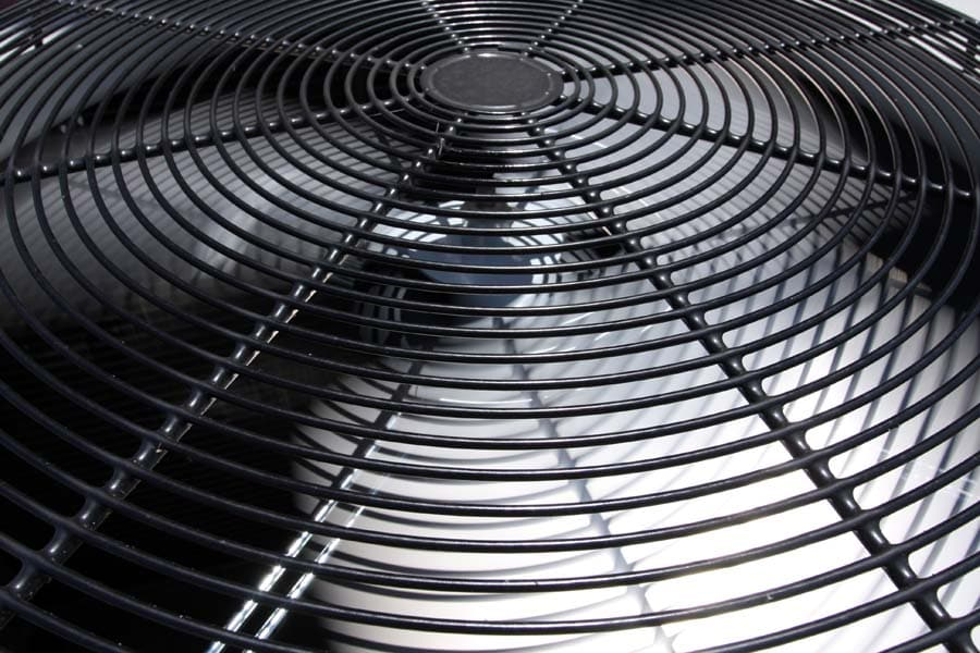 The top fan component of an AC system showing one of the things to consider when learning how to properly size your unit.