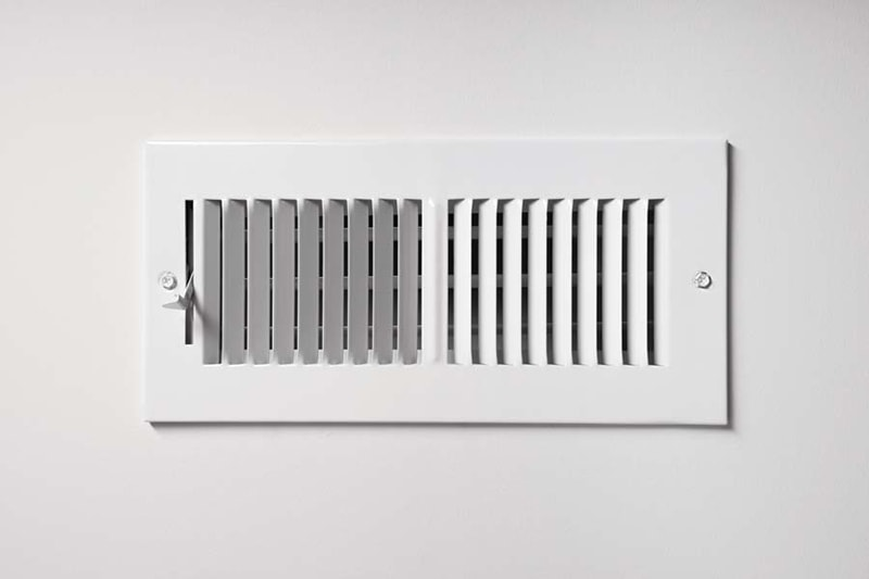 ac definitions, A heating/cooling vent register on the wall of a home, with open/close lever