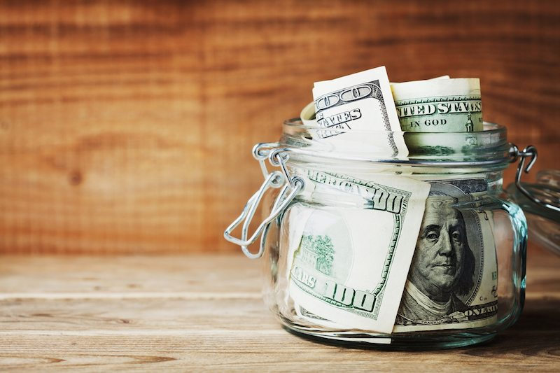 save money on your heating bill with dollar bills in a glass jar.