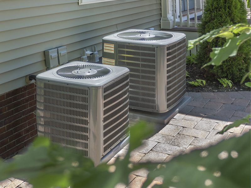 Multiple air conditioner units outside of a house in Cornelius